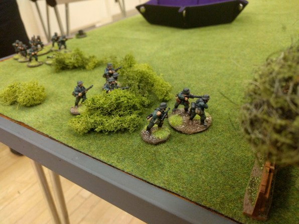 The main German attack develops, with two squads moving up to the houses
