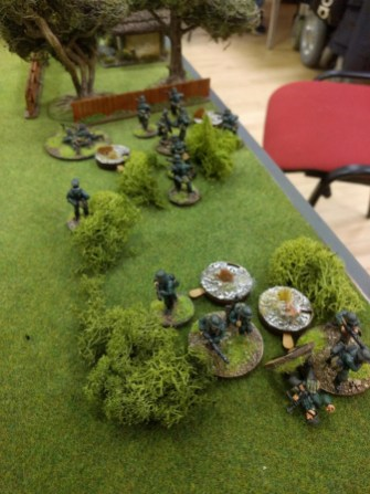 Shot up by the HMG and ambushed by a flamethrower, one squad falls back dragging their unconscious NCO and putting a load of shock on their mates