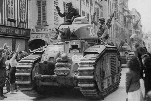 Interesting photo of a Char B1 gun tank captured back from the Germans and used by Free French forces to liberate this French town