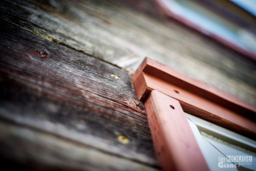 Notched siding around window trim