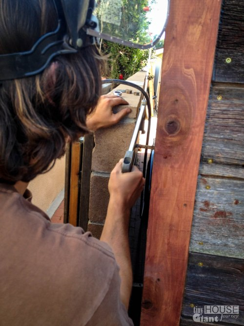 Cutting the gate's metal rod