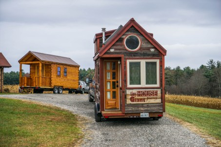 Larger tiny home visible behind Tiny House GJ