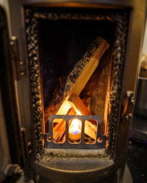 Starting a fire with a fire starter and wood fuel