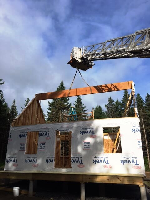 Lifting the roof beam into place.