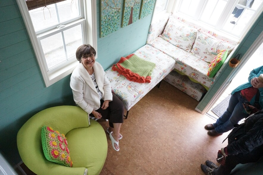 Patti Cannan sitting on her couch bed