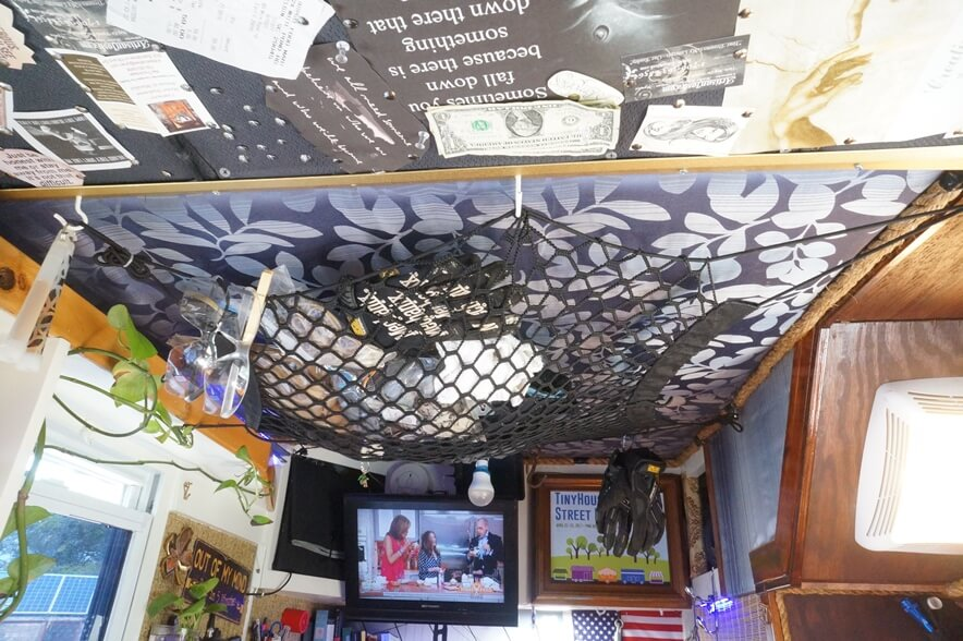 Tiny house ceiling with storage net.