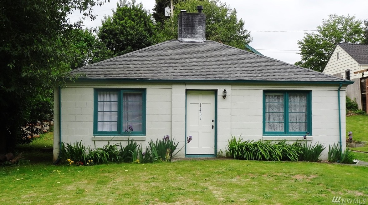 Historical 720 sq ft cinder block cottage for sale for Cinder block house construction