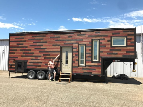 couple build a solar powered steel framed tiny house on wheels. Black Bedroom Furniture Sets. Home Design Ideas