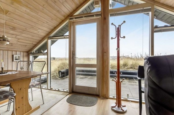 floor to ceiling windows in A frame home