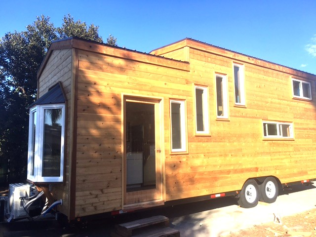 Habitats tiny home with bay window for sale for Home windows for sale