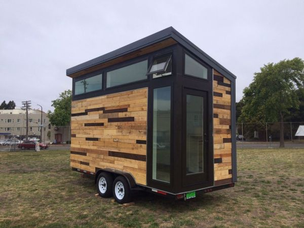 High school students build tiny houses on wheels for 100 sq ft tiny house