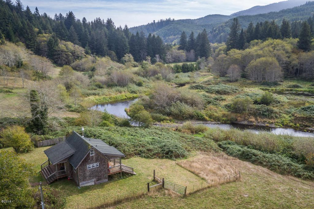 Riverfront Small Home On 40 Breathtaking Acres In Oregon
