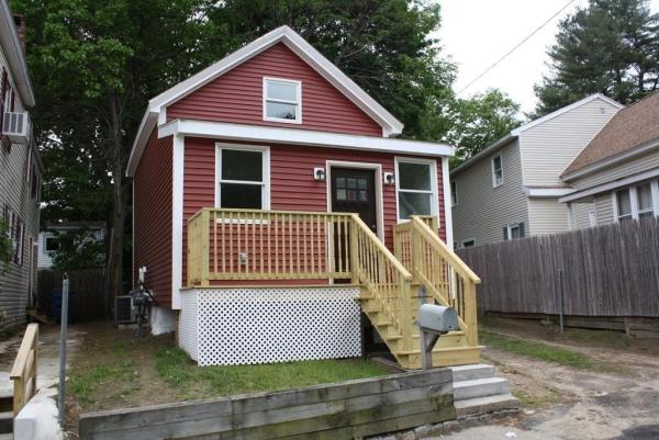 Tiny Red Cottage in Lawrence MA