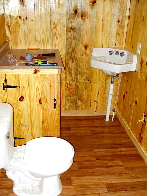 Bathroom with Toilet and Door Added for Water Heater Enclosure