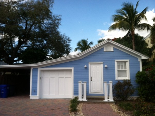 Blue Tiny House with a Garage