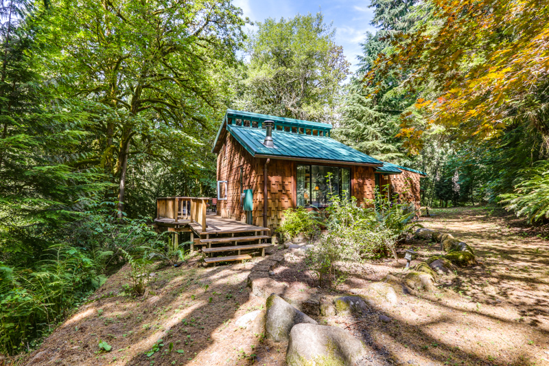 Two small cabins and a yurt nestled in the woods for Cabin in the woods oregon