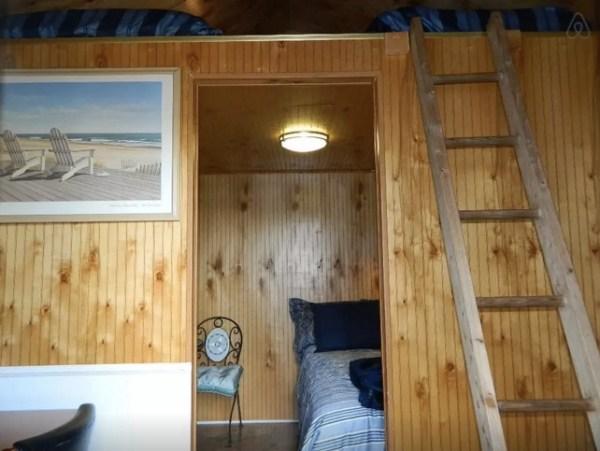 view inside micro cabin with sleeping loft