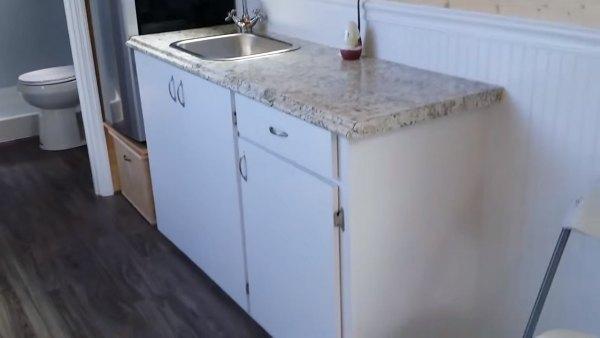 custom-tiny-house-with-split-level-floor-plan-005