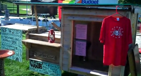Deek's booth at freedom rally - the box lady - micro cabin