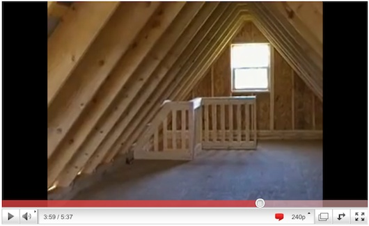 Inside the loft in a small log cabin shed