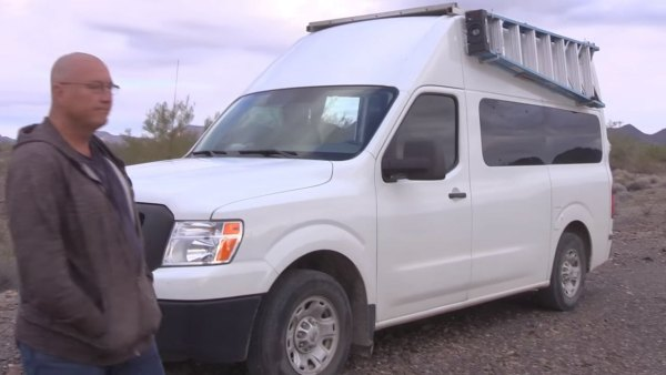 man-living-off-grid-in-nissannv-2500-van-001