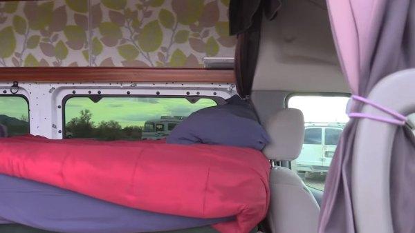 man-living-off-grid-in-nissannv-2500-van-002