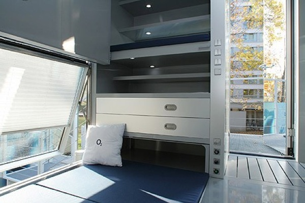 Table Turns to Bed inside Micro Compact House