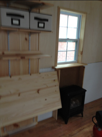 shirleys-mortgage-free-tiny-house-interior-construction-fireplace-table-storage