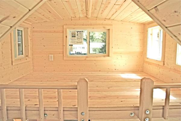 Roomy Sleeping Loft in Tiny House Because Roof Pitch