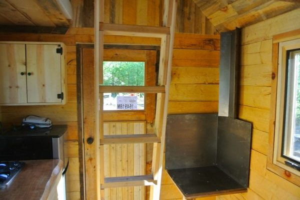 stanley-rocky-mountain-tiny-houses-log-cabin-on-wheels-flipping-overhangs-greg-parham-00010