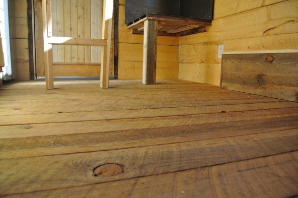 stanley-rocky-mountain-tiny-houses-log-cabin-on-wheels-flipping-overhangs-greg-parham-0004