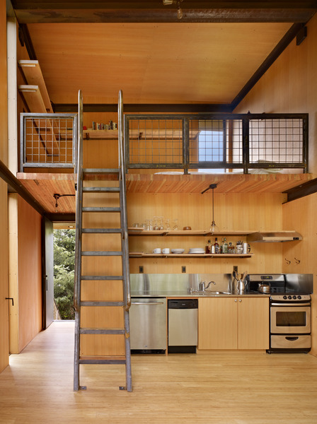 steel-clad-tiny-modern-cabin-with-shutters-on-stilts-05