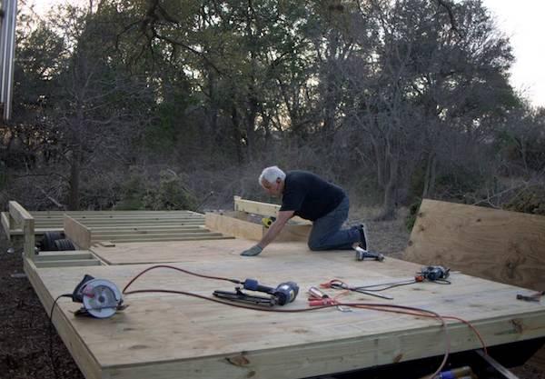 Steve installing deck on floor joists