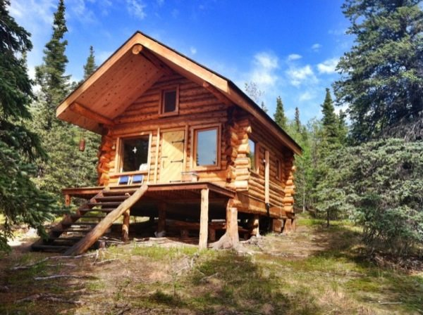Folks living the simple life in tiny cabin in alaska for Alaska log home builders