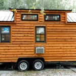 Securing a Tiny House on Wheels After Parking With Tire Locks for the Trailer Tires