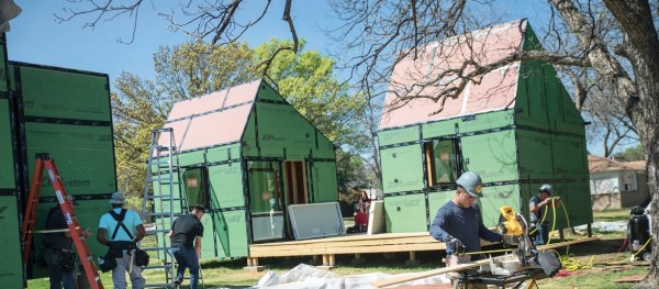 students building tiny houses