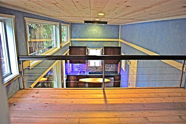 View from sleeping loft in surfers oceanfront tiny house by Molecule Homes