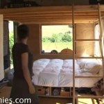 Woman Living in Shipping Container Home Conversion and Tiny House on a Flatbed Trailer with Family