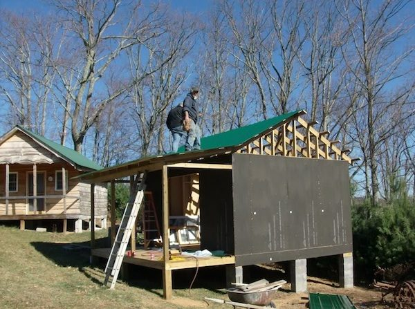 Working on the Roof of our Tiny Cabin