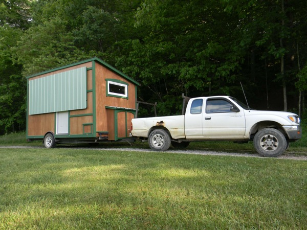 112 square feet off grid tiny house with folding porch roof