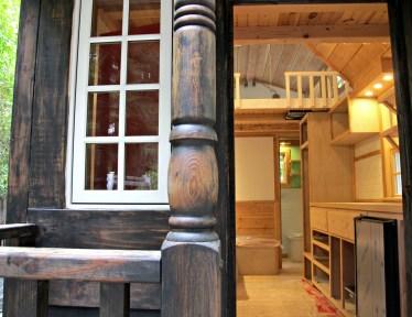 Porch column and open front door.