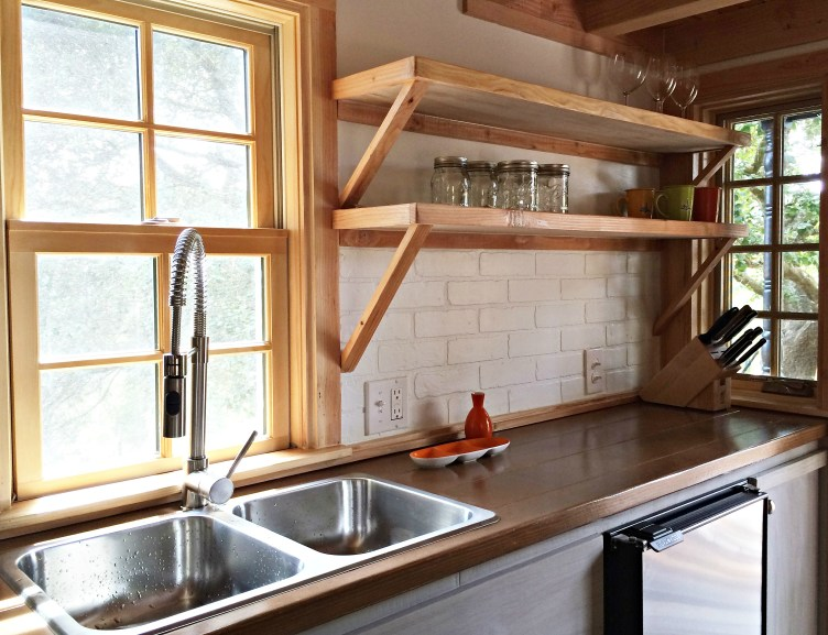 A shot of the kitchen and open shelving, taken before we unpacked our dishes.