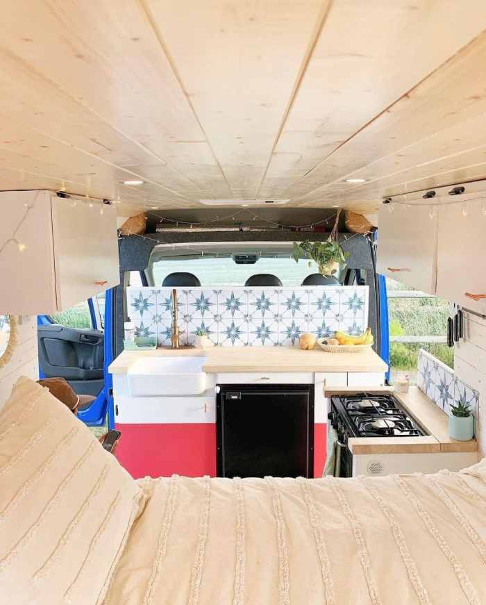 Camper Van Kitchen Layouts with a bed