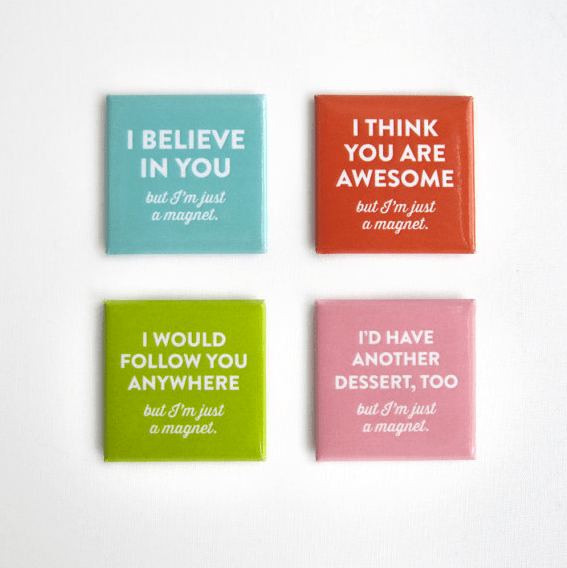 4 magnets with phrases.
