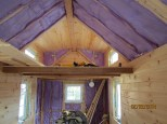 The bedroom loft with most of the siding up and a ceiling - just the dormer sides to do!