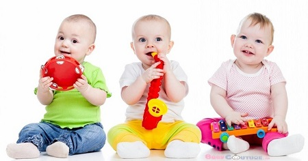 Image of cute babies playing with toys.
