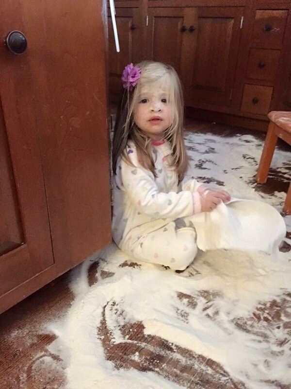 messy kid with flour