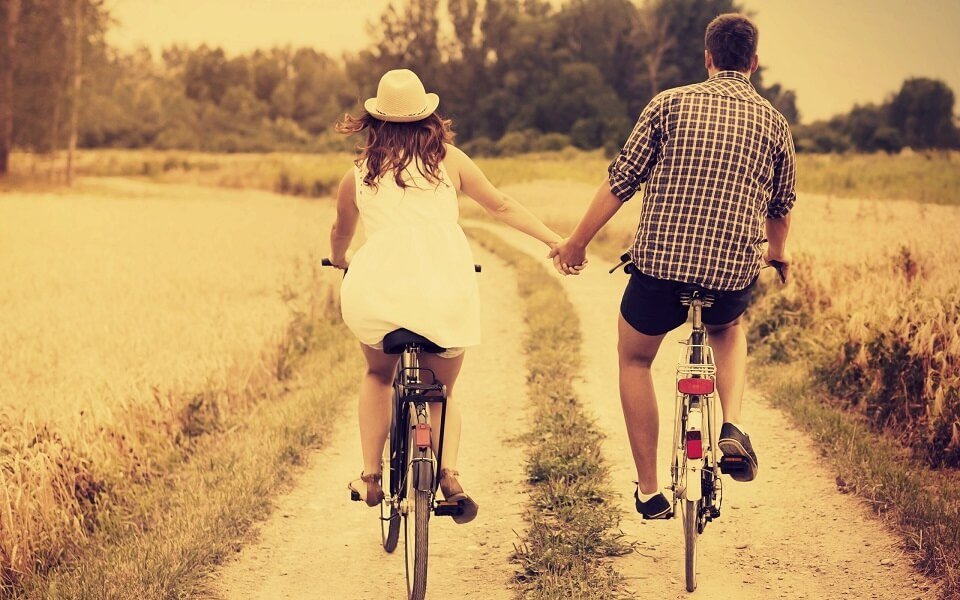 husband wife cycling together