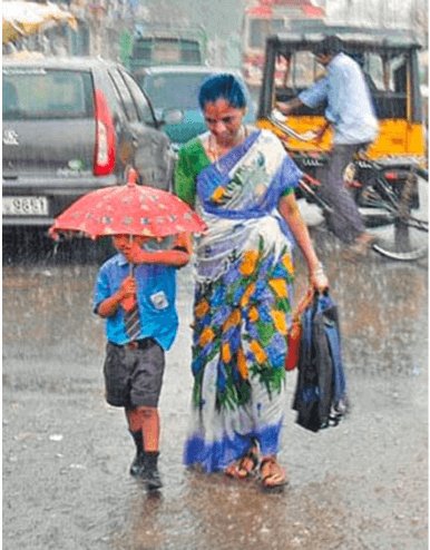 Mom taking her kid to school in the rain holding her hand