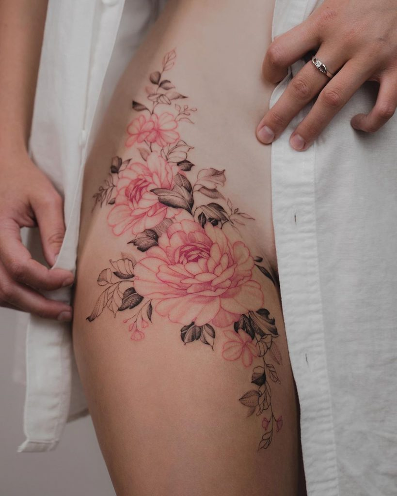 colored florals tattoo on thigh